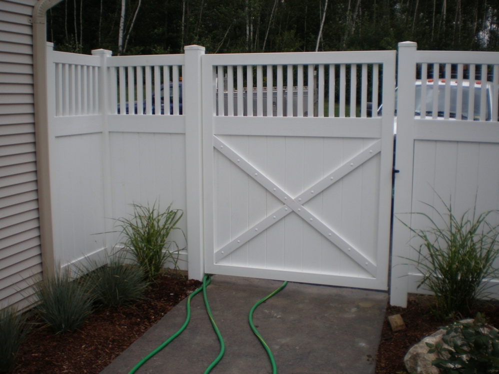 A Vinyl Gate With Spindle Top.