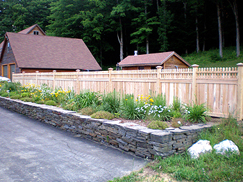Privacy Fence with Rock Garden